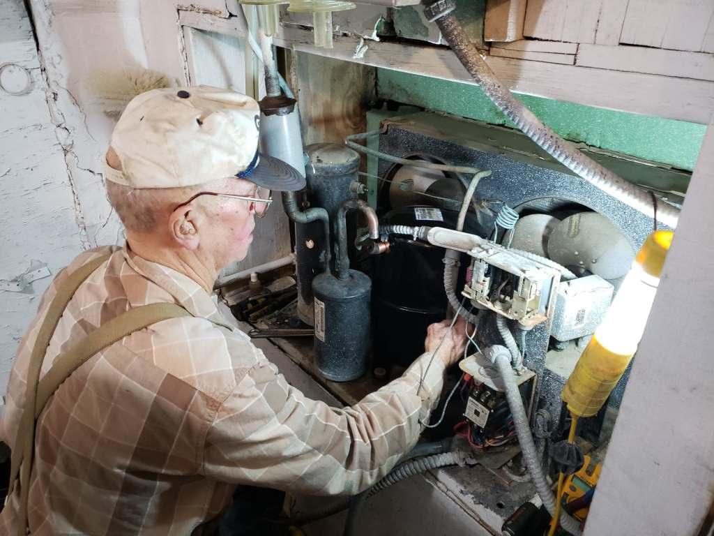Teddy Marshall working on a dairy farm.